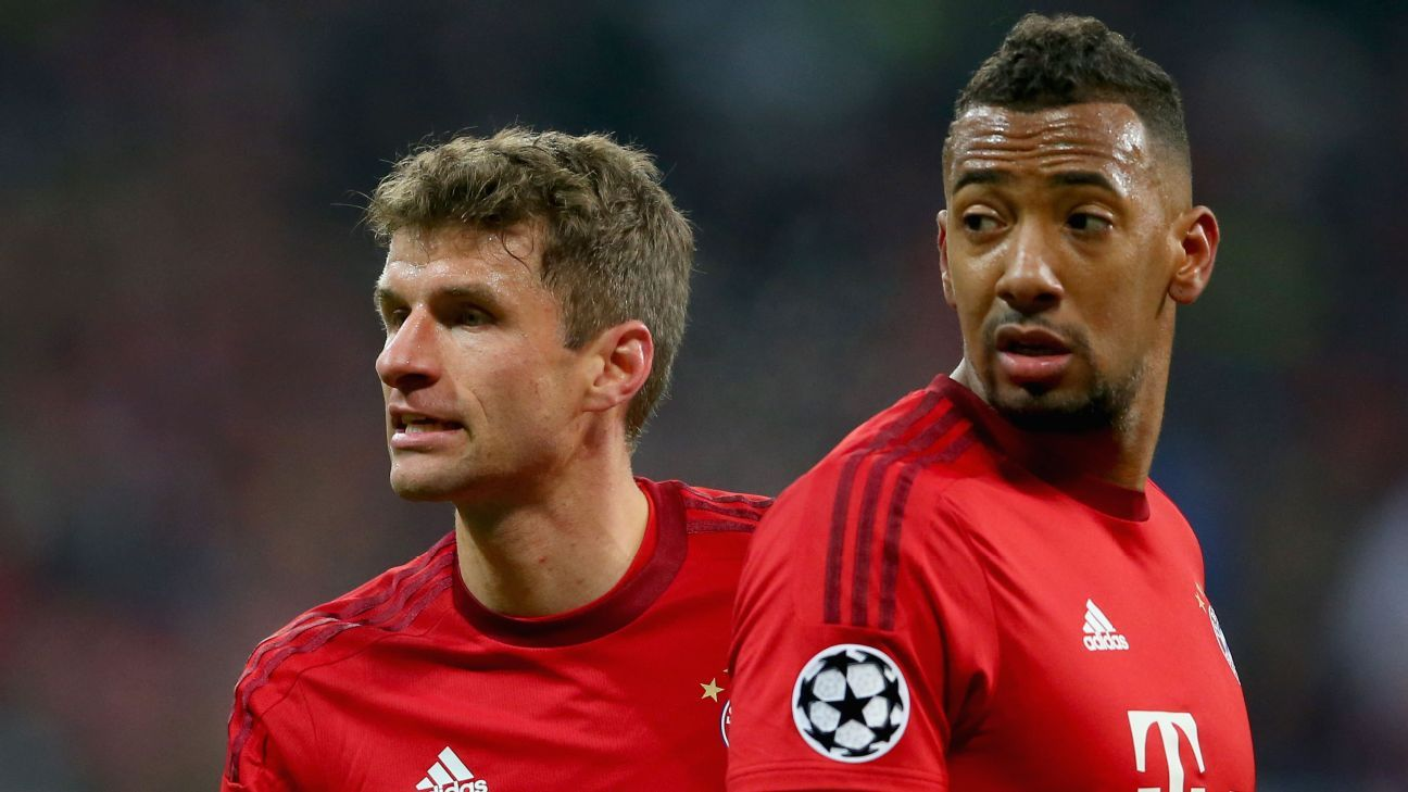 Thomas Mueller looks on with teammate Jerome Boateng (R) during the Champions League Group F match between FC Bayern Muenchen and Olympiacos FC at Allianz Arena on November 24 2015 in Munich, Germany. (Photo by Alexander Hassenstein/Bongarts/Getty Images)