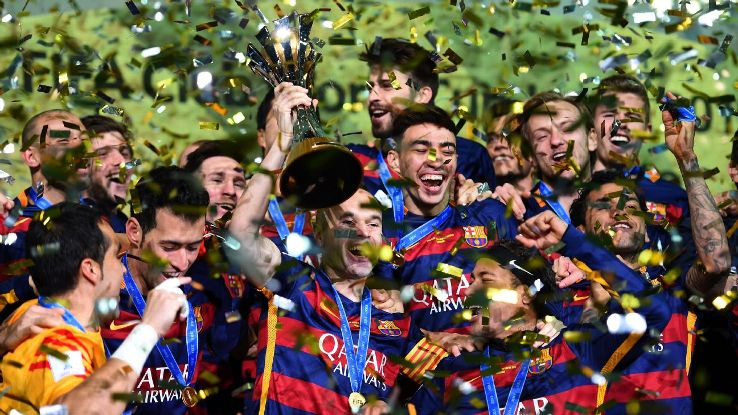 Barcelona celebrate as captain Andres Iniesta lifts the trophy following their 3-0 FIFA Club World Cup Final win against River Plate at the International Stadium Yokohama on December 20, 2015 in Japan. (Shaun Botterill - FIFA/FIFA via Getty Images)