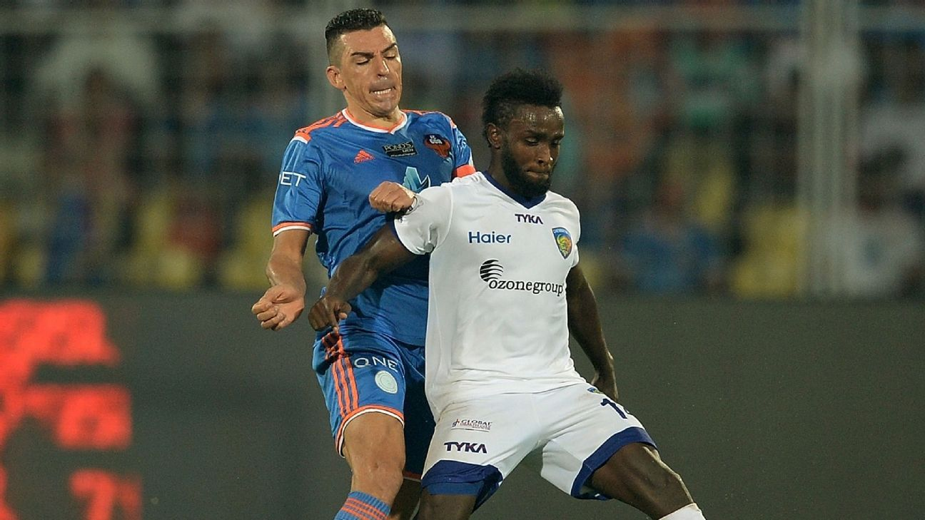 Lucio and Stiven Mendoza struggle for the ball during the ISL final between Chennaiyin FC and FC Goa