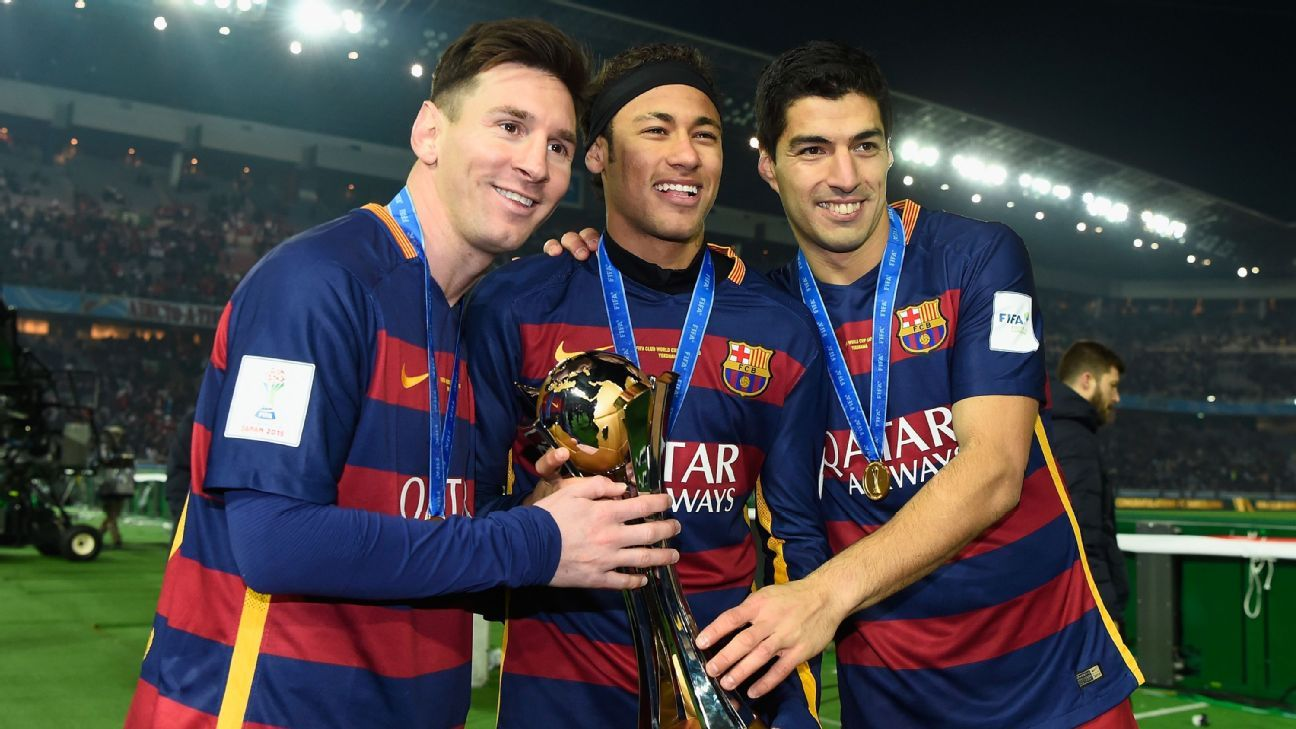 Lionel Messi, Neymar and Luis Suarez hold the Winner's Trophy after the FIFA Club World Cup Japan 2015 Final between River Plate and FC Barcelona at International Stadium Yokohama on December 20, 2015 in Japan. (Photo by Mike Hewitt - - FIFA via Getty)