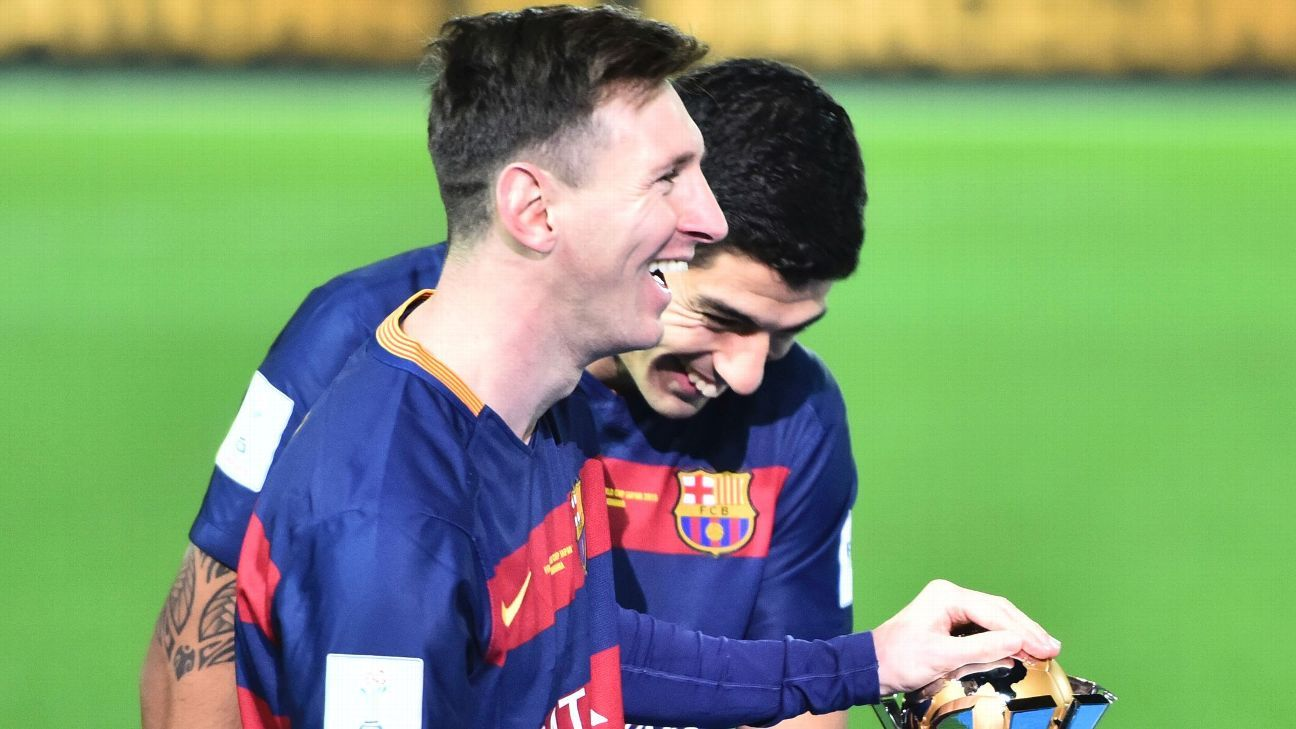 Lionel Messi of Barcelona and Luis Suarez laugh after winning the FIFA Club World Cup final match between River Plate and FC Barcelona at International Stadium Yokohama on December 20, 2015 in Yokohama, Japan. (Photo by Amilcar Orfali/LatinContent/Getty)