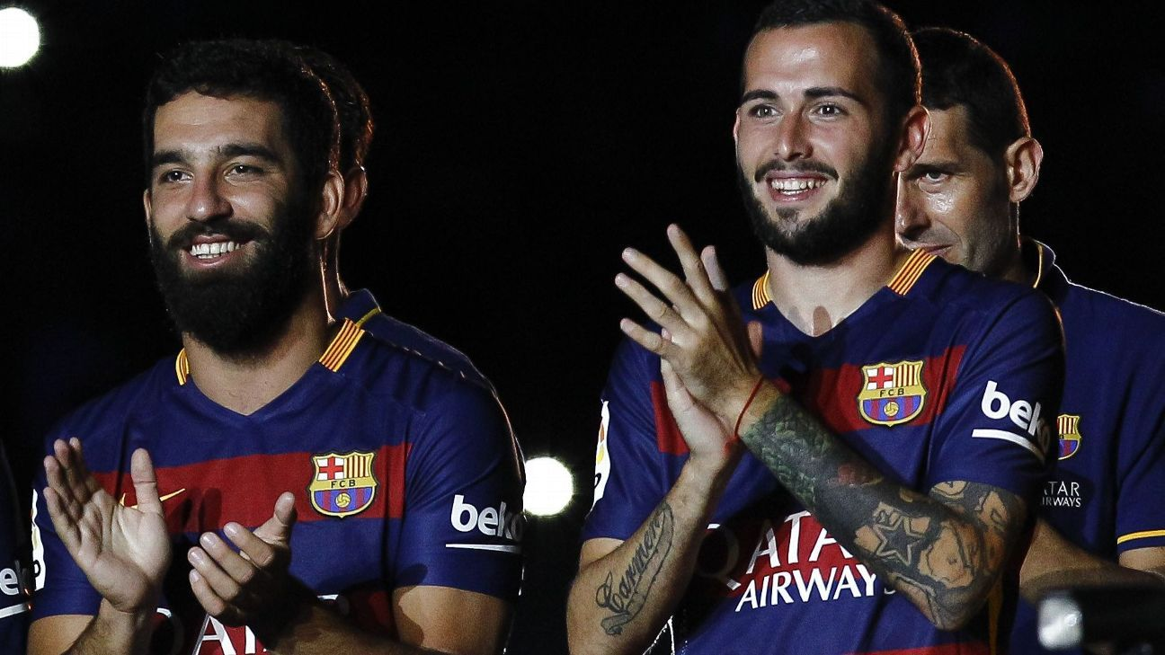Midfielder Arda Turan, left, and defender Aleix Vidal, right, will add some much-needed depth to Barcelona.