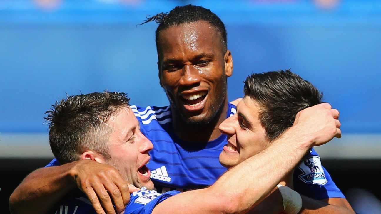 Gary Cahill, Didier Drogba and Thibaut Courtois of Chelsea celebrate winning the Premier League title after the match between Chelsea and Crystal Palace at Stamford Bridge on May 3, 2015 in London, England. (Photo by Clive Mason/Getty Images)