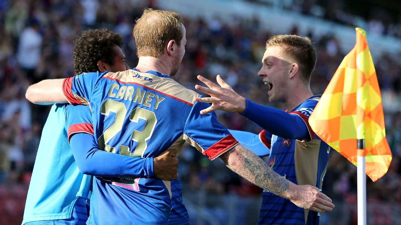 David Carney of the Jets celebrates his goal with team mates during the round 15 A-League match between the Newcastle Jets and the Wellington Phoenix at Hunter Stadium on January 17, 2016 in Newcastle, Australia. (Photo by Tony Feder/Getty Images)