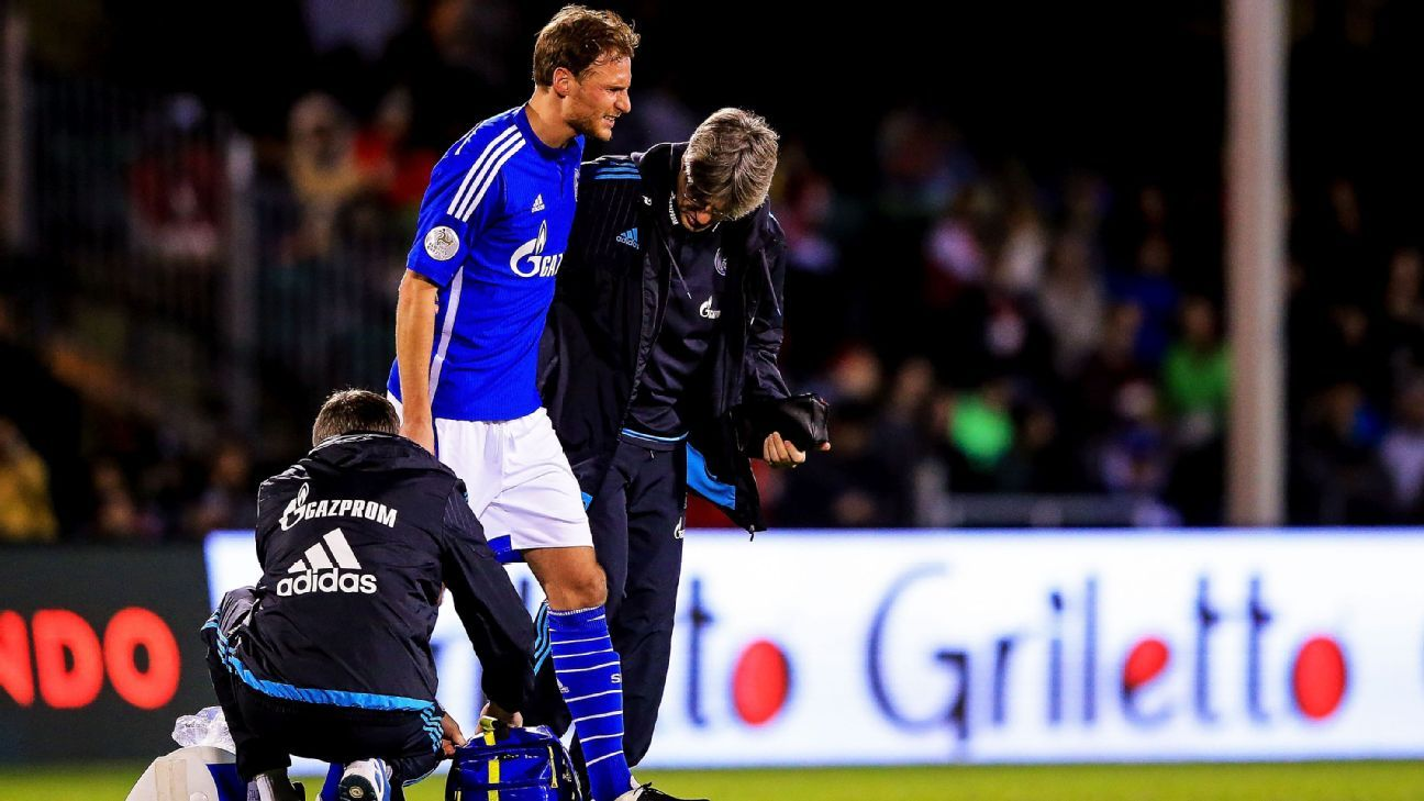 Benedikt Hoewedes #4 of FC Schalke 04 is taken out of the match against the Fort Lauderdale Strikers after being injured at the ESPN Wide World of Sports Complex on January 10, 2016 in Kissimmee, Florida. (Photo by Rob Foldy/Bongarts/Getty Images)