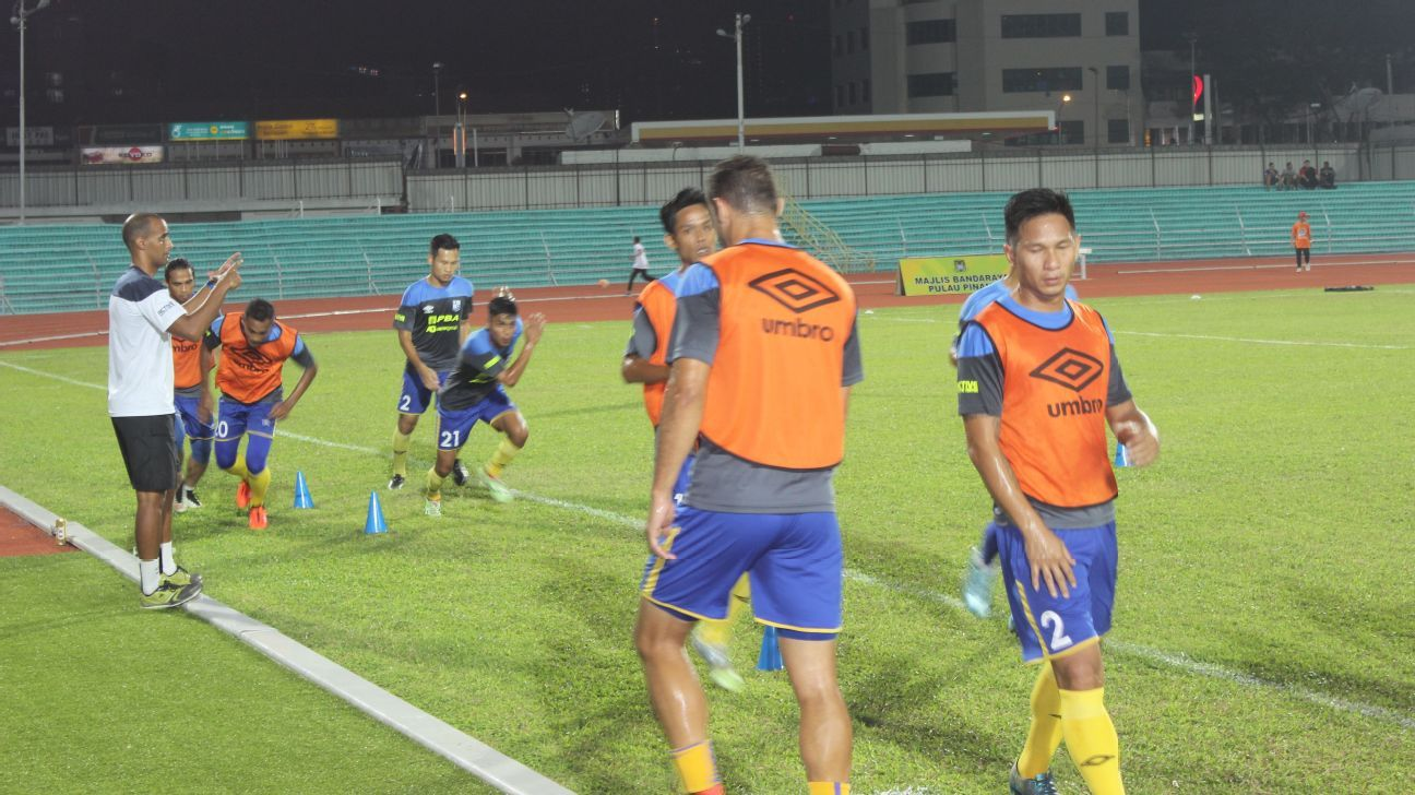 Penang players warming up