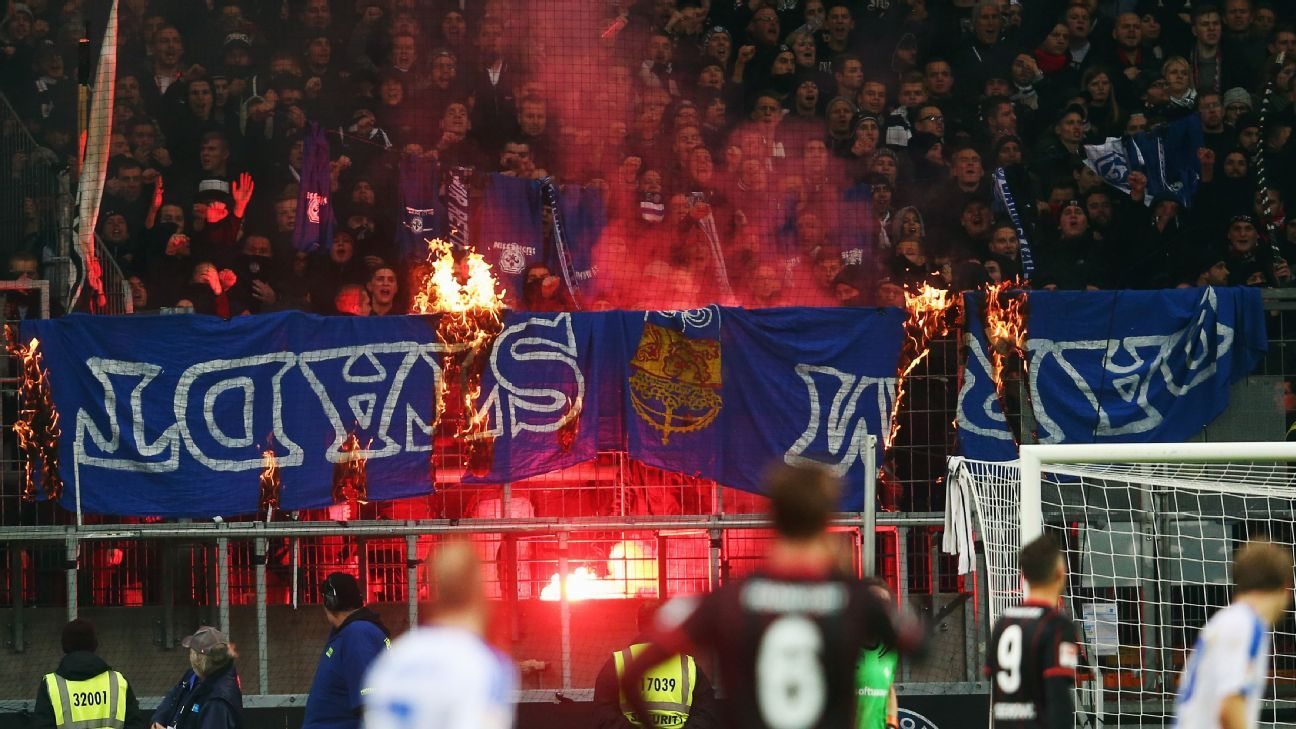 Fans of Frankfurt burn Darmstadt banners during the Bundesliga match between Eintracht Frankfurt and SV Darmstadt 98 at Commerzbank-Arena on December 6, 2015 in Frankfurt am Main, Germany. (Photo by Alex Grimm/Bongarts/Getty Images)