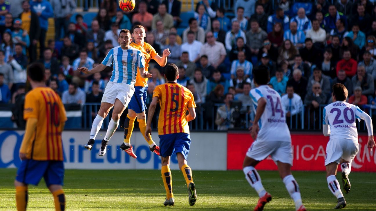 Barcelona defender Thomas Vermaelen, seen here vying for a header with Malaga forward Charles, endured a miserable first half at La Rosaleda.