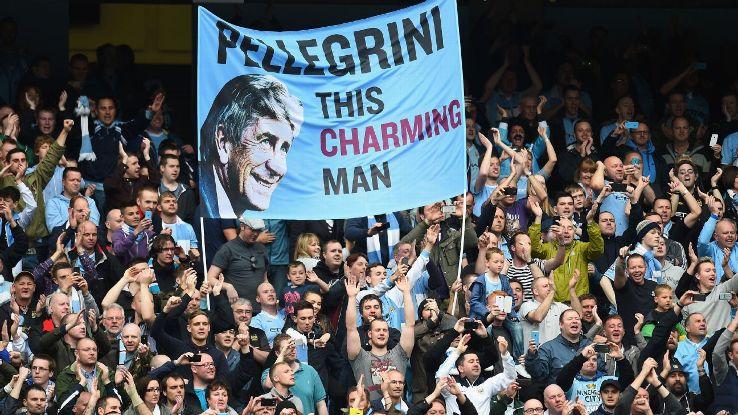 Man City fans with Pellegrini banner