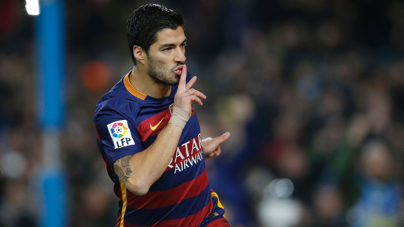Luis Suarez collected a brace in each half against beleaguered Valencia.
