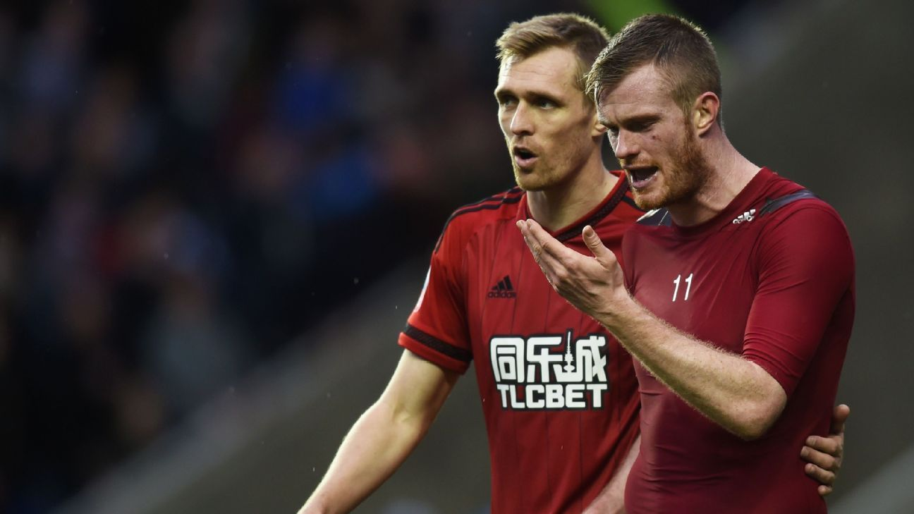 Chris Brunt, right, was none too pleased after being hit in the face with a coin following West Brom's 3-1 FA Cup defeat vs. Reading.
