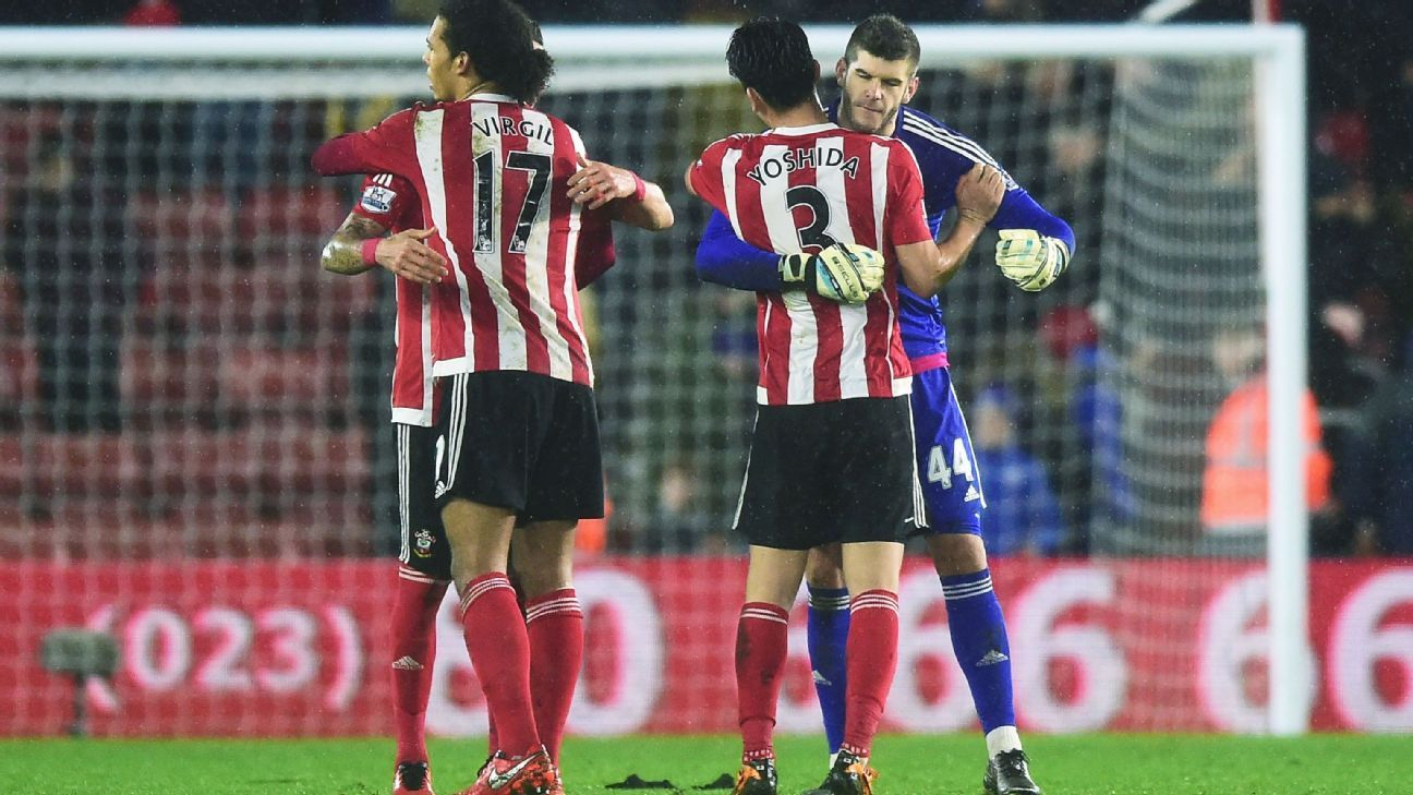 Southampton goalkeeper Fraser Forster, far right, has gotten a big hand from centre-back Virgil van Dijk, left, during his clean sheet streak.