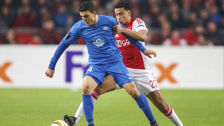 Mohamed Elyounoussi (left) of Molde battles with Jairo Riedewald of Ajax in the UEFA Europa League.