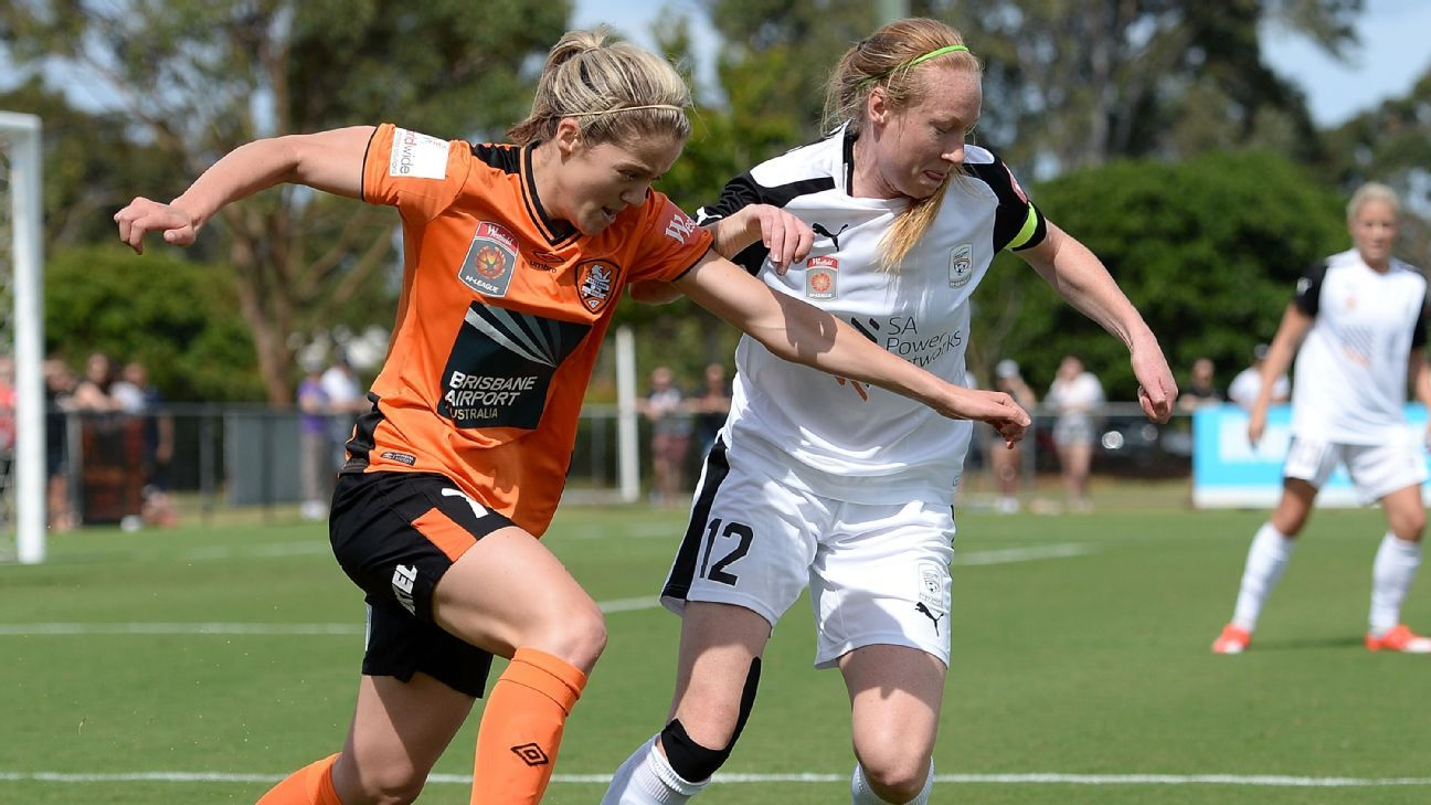Gabrielle Marzano of Brisbane Roar and Elizabeth Milne of Adelaide United challenge for the ball during the round three W-League match on November 1, 2015