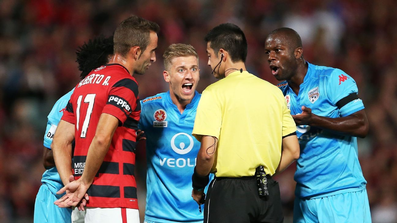Stefan Mauk and Bruce Djite of Adelaide protest to the referee