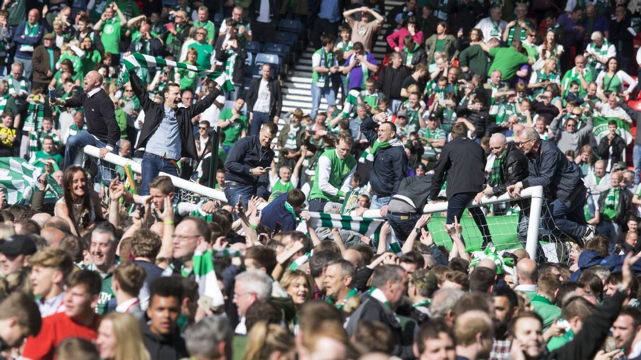 Hibernian fans celebrated on the pitch after the final whistle at Hampden Park.