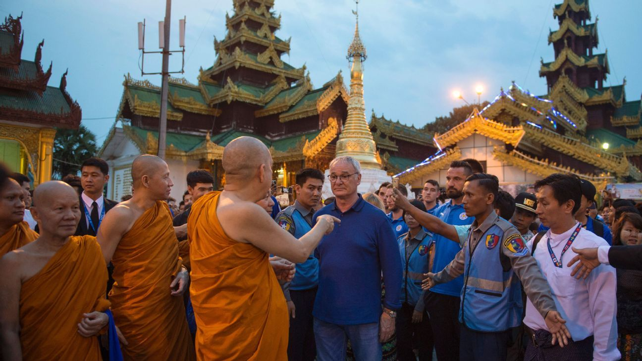 Claudio Ranieri (C), manager of English Premier League champions Leicester City meets Buddhist monks during a visit to Yangon city's landmark Shwedagon pagoda on May 22, 2016.