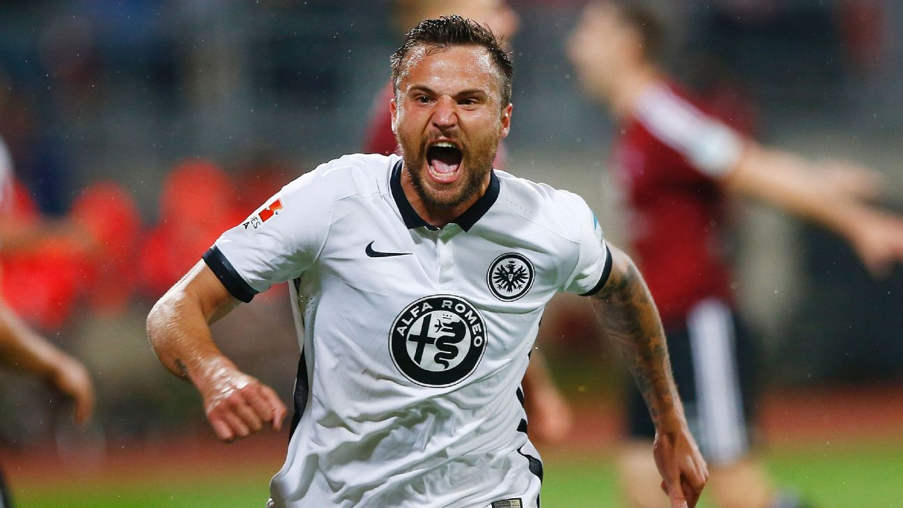Haris Seferovic celebrates after scoring the goal that secured Eintracht Frankfurt's spot in the Bundesliga next season.