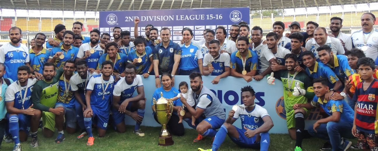 The Dempo players celebrate with the second division trophy