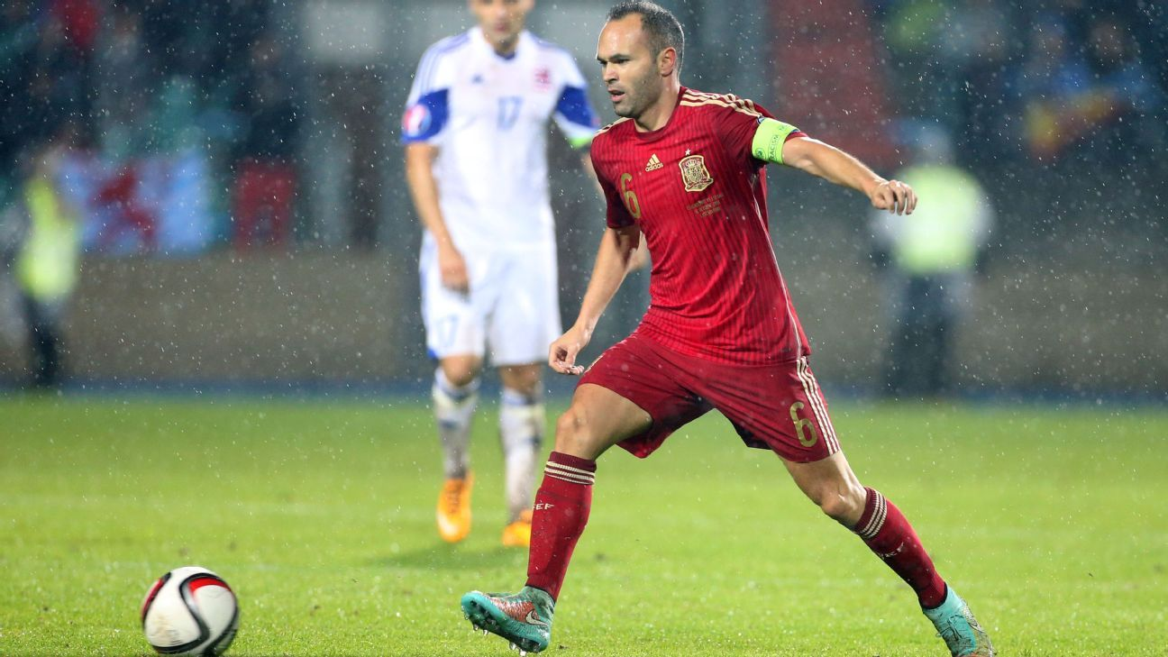 Andres Iniesta with Spain