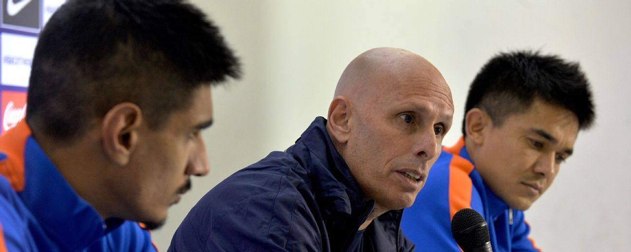 Indian football coach Stephen Constantine (centre) and Sunil Chhetri (right).