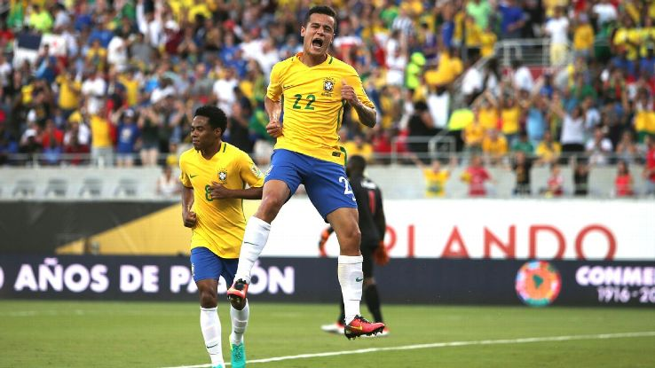 Coutinho celebrates the first of his three goals against Haiti on Wednesday.