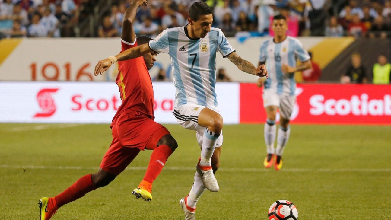 Argentina's Angel Di Maria makes a run at goal before being substituted with an apparent injury in his team's match vs. Panama.
