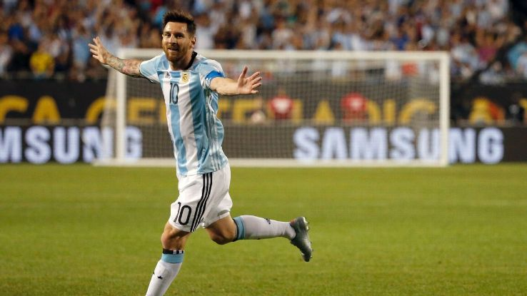 Lionel Messi celebrates after scoring a hat trick as a substitute in a 5-0 win vs. Panama.
