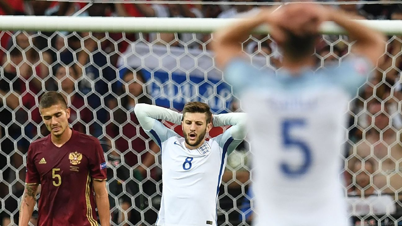 England's Adam Lallana shows his frustration after a missed chance against Russia.