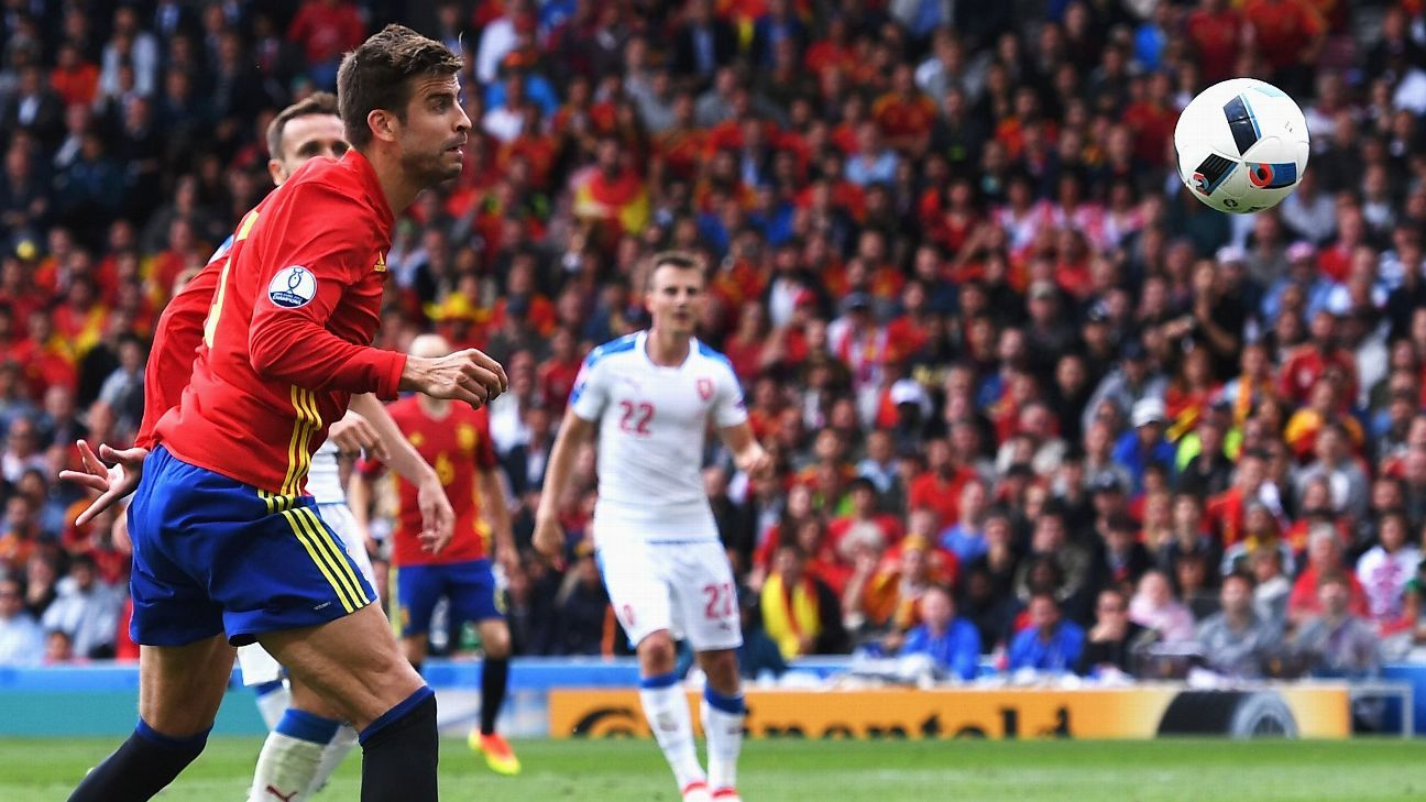 Gerard Pique heads Spain into the lead against Czech Republic.