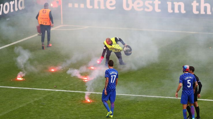 Croatia fans threw flares on the pitch in the 86th minute.