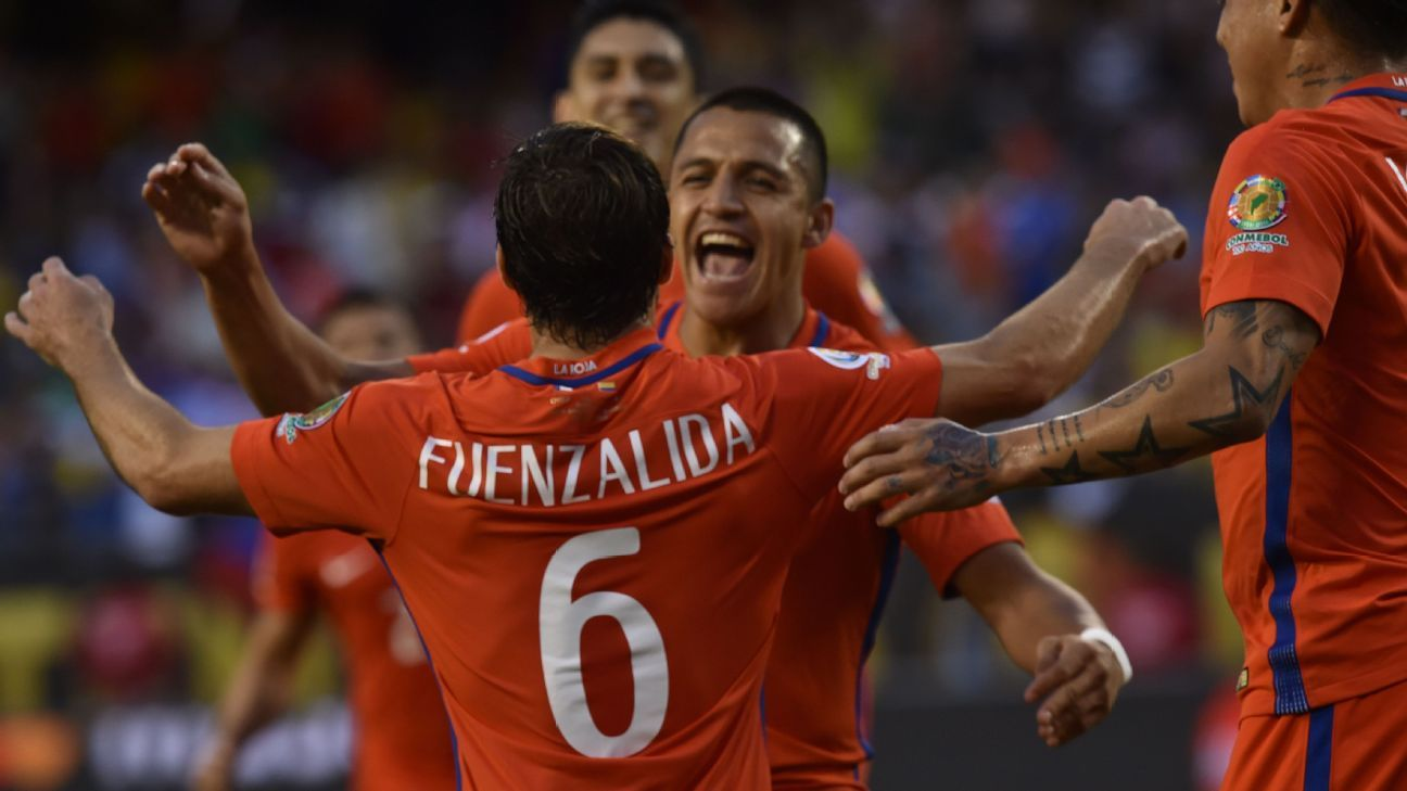 Chile players celebrate after opening the scoring vs. Colombia in the Copa America semifinals.