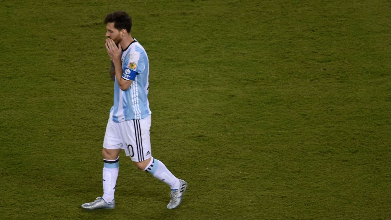 Lionel Messi walks away in disbelief after Argentina lose on penalties to Chile.