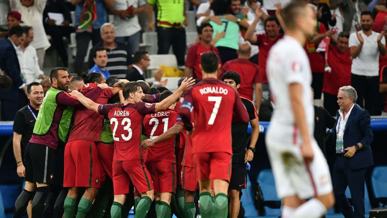 Portugal celebrate their equalising goal against Poland.