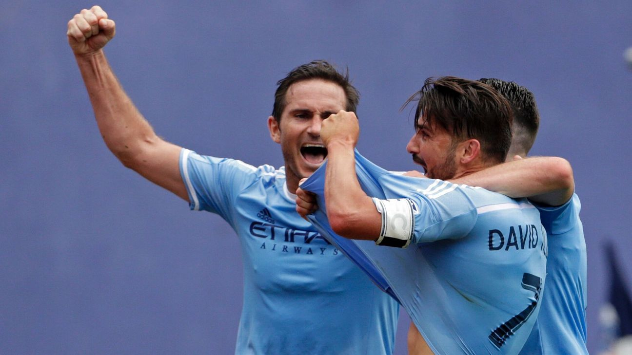David Villa, right, and Franck Lampard celebrate after NYCFC scored a goal against NY Red Bulls on Sunday.