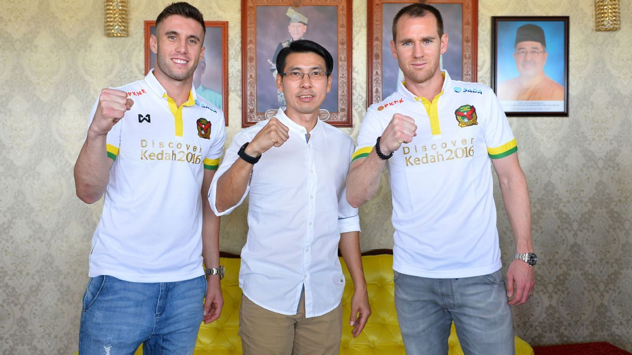 Kedah's Shane Smeltz and Thiago Augusto Fernandes with Tan Cheng Hoe