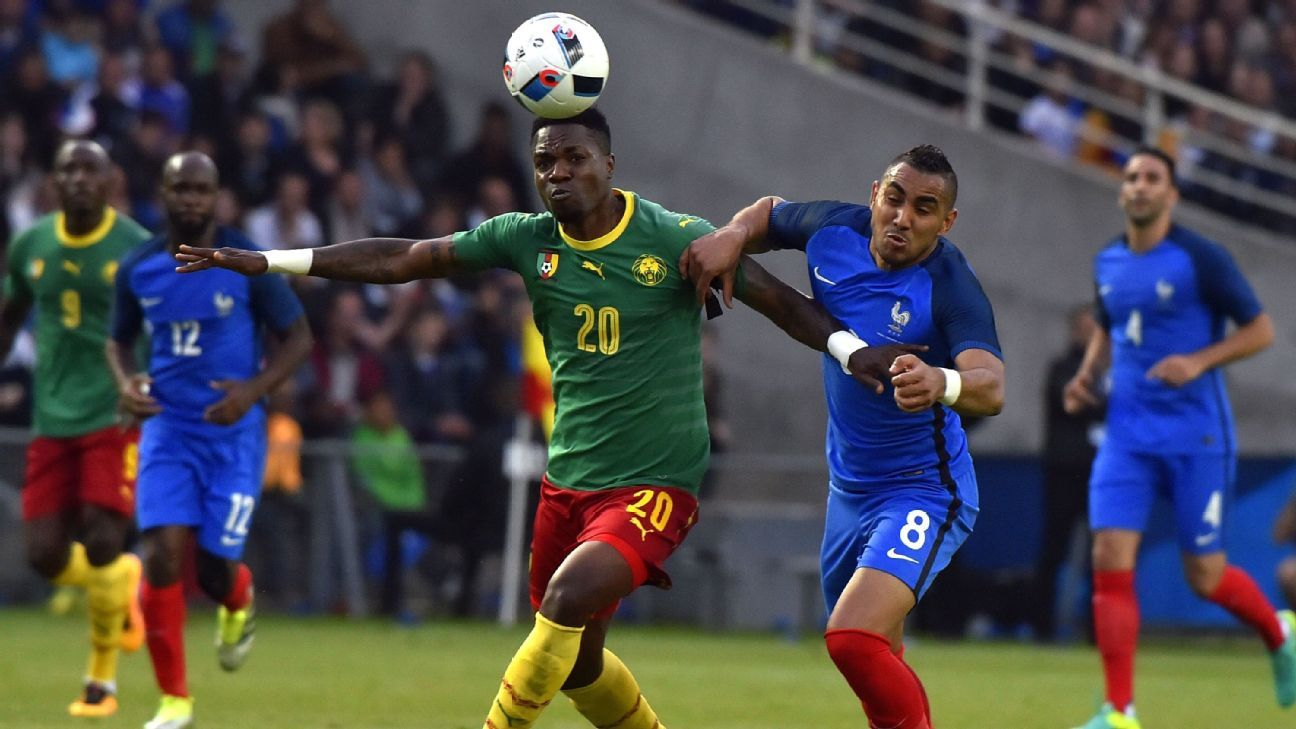 Georges Mandjeck of Cameroon battles France's Dimitri Payet