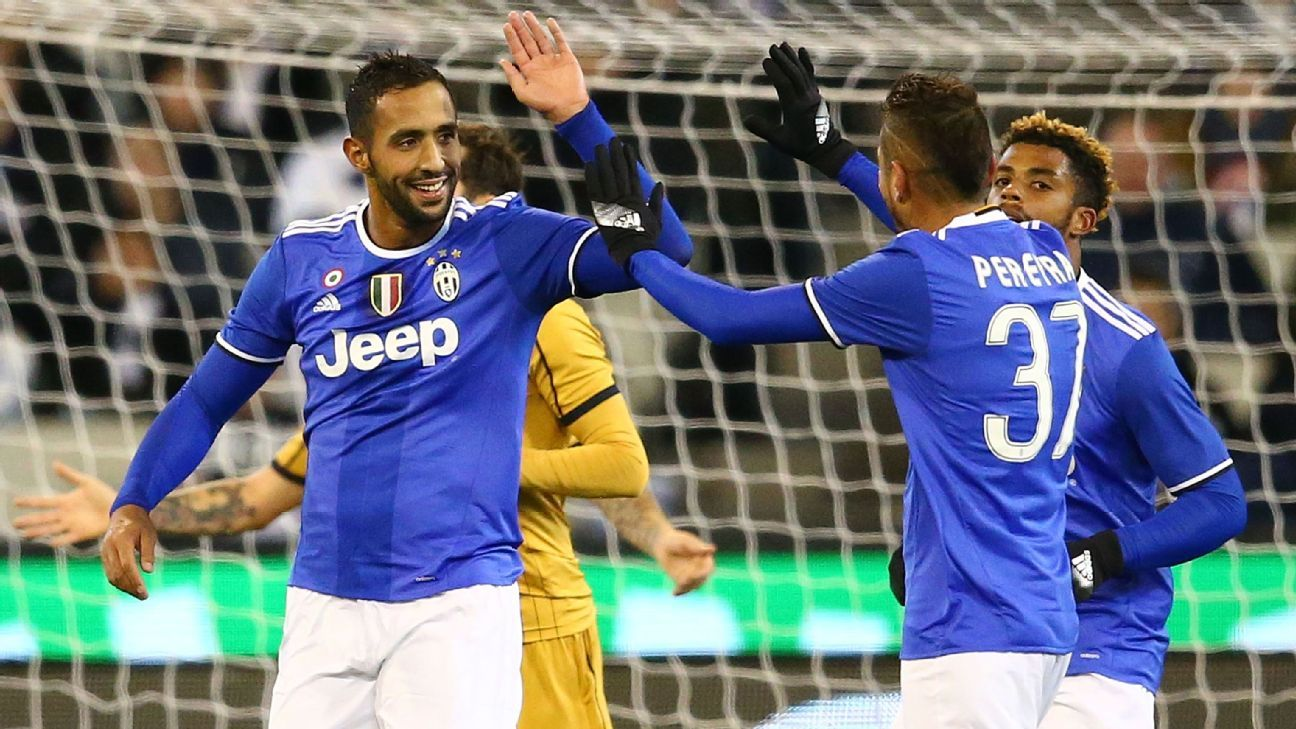 Medhi Benatia celebrates with teammates after scoring the winning goal.
