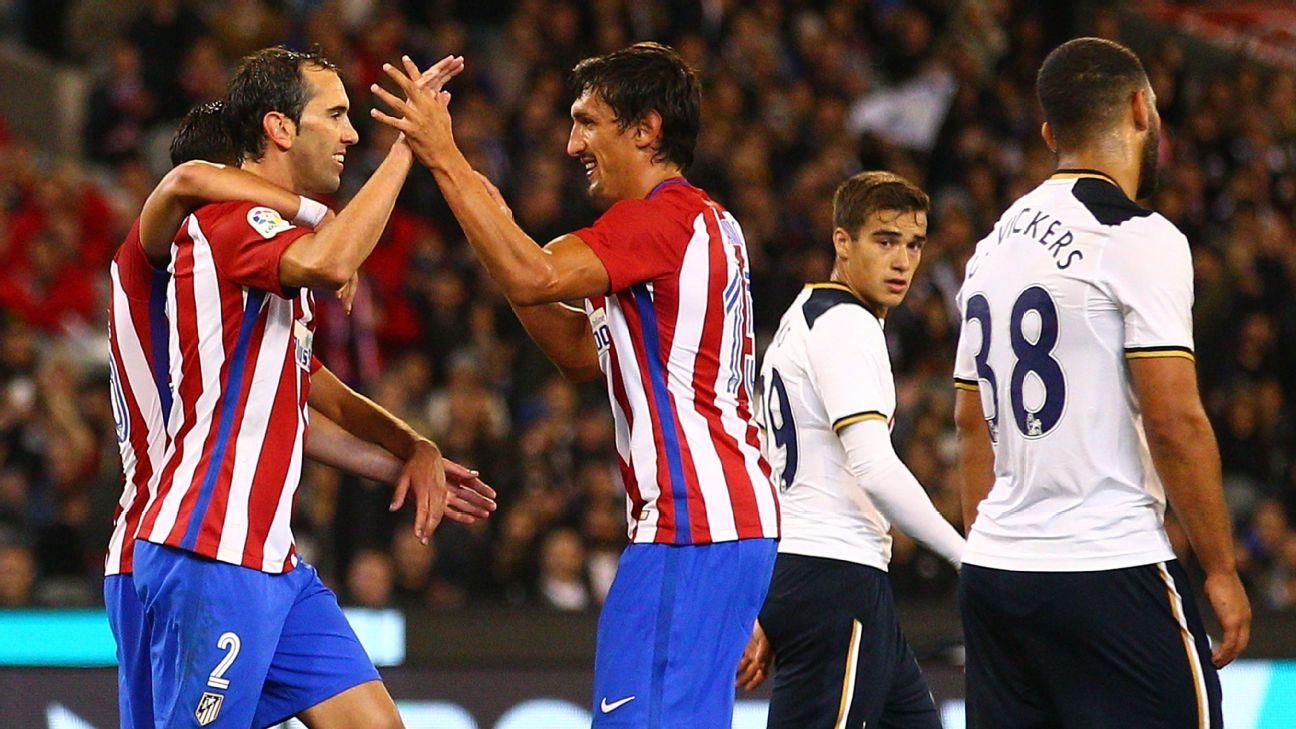 Atletico Madrid celebrate Diego Godin's goal.