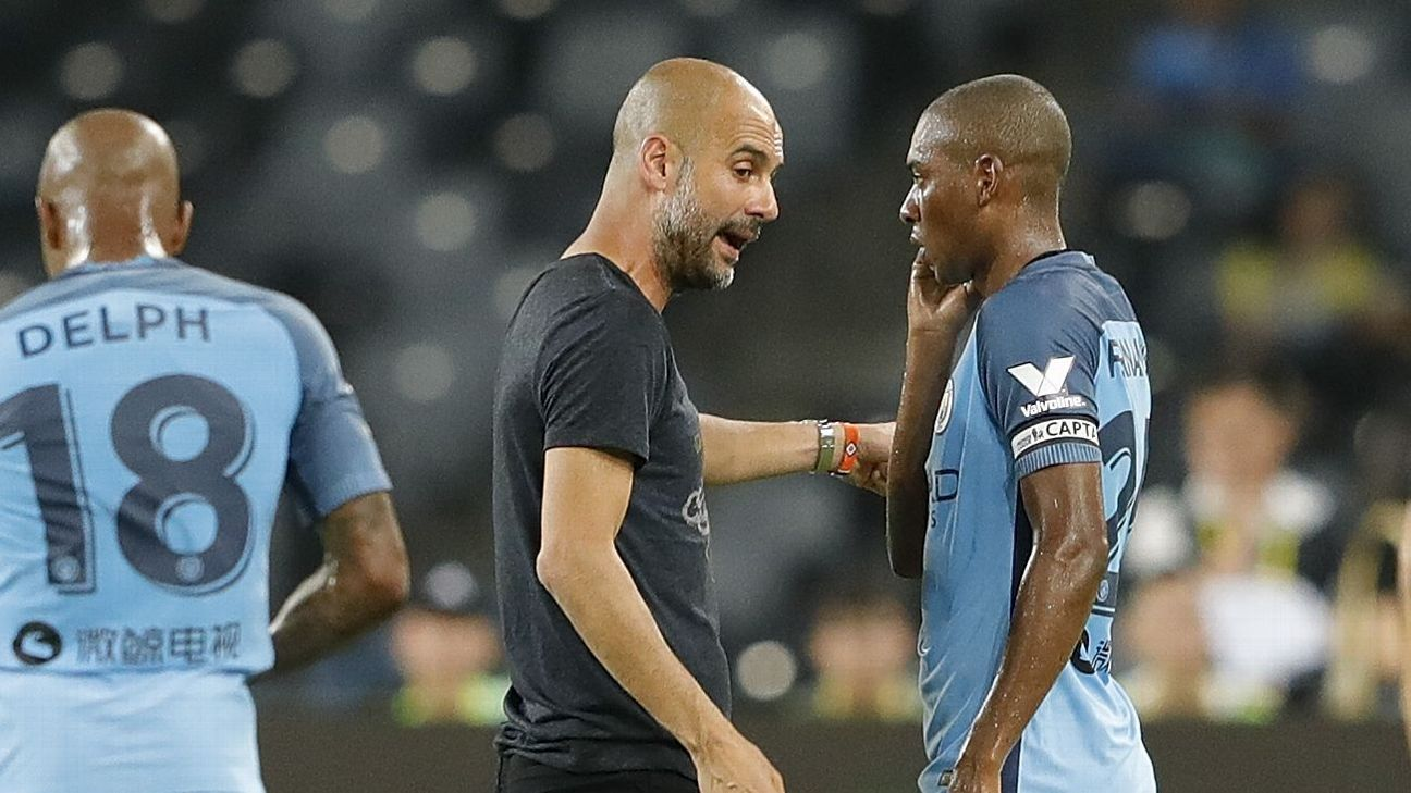 Fernandinho and Pep Man City