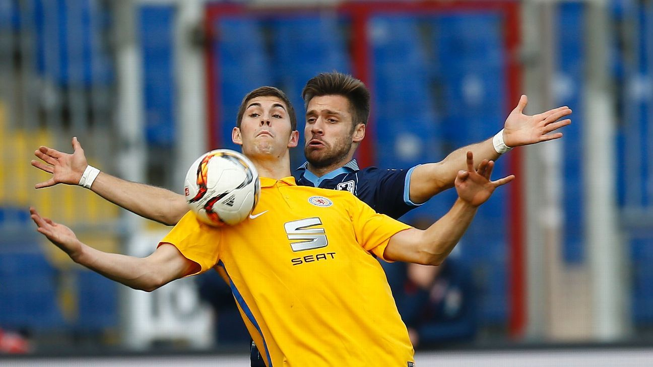 Emil Berggreen of Braunschweig challenges Gary Kagelmacher of 1860 Muenchen during the second Bundesliga match between Eintracht Braunschweig and 1860 Muenchen at Eintracht Stadion on November 8, 2015 in Braunschweig, Germany.
