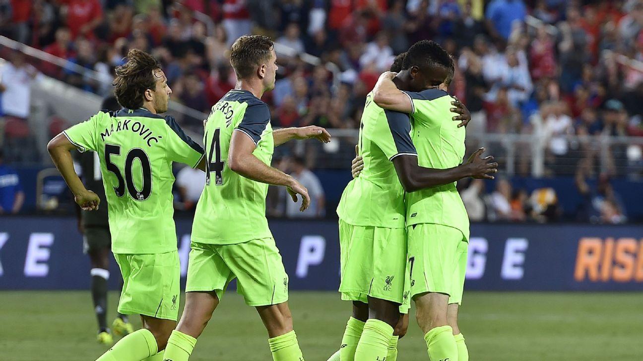 Liverpool celebrates Divock Origi's opening goal against AC Milan.