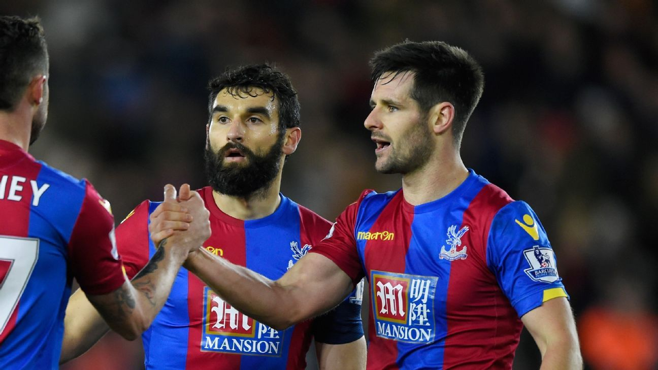 Mile Jedinak and Scott Dann