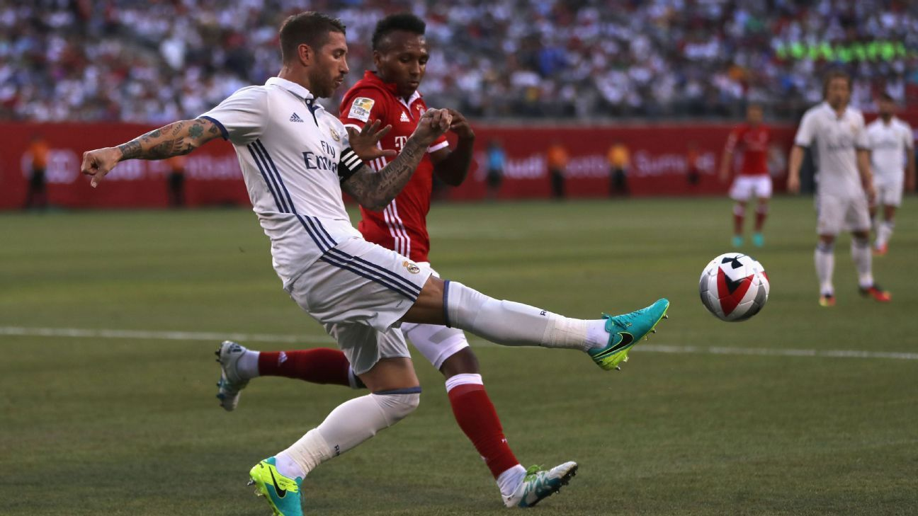 Julian Green and Sergio Ramos battle for the ball in the first half of Real Madrid's win vs. Bayern Munich.