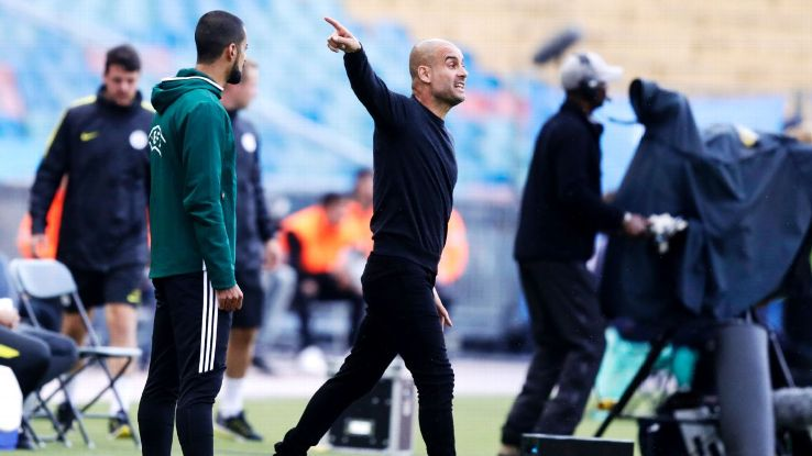 Pep Guardiola communicates with his Manchester City players during a friendly match vs. Arsenal.