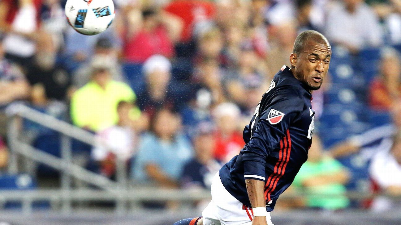 New England Revolution forward Teal Bunbury heads the ball against the Chicago Fire.