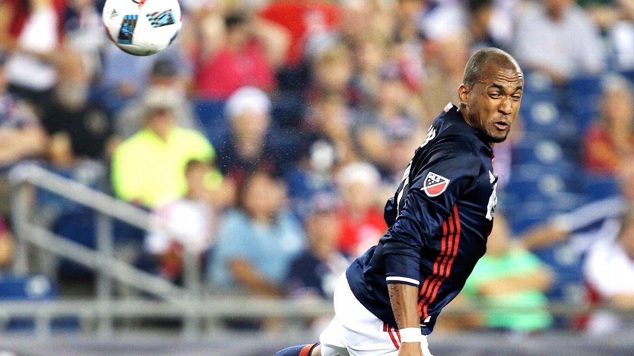 New England Revolution forward Teal Bunbury heads the ball against the Chicago Fire.