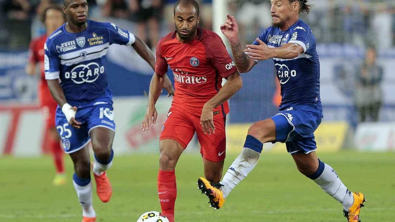 Lucas Moura vies with Bastia's Mehdi Mostefa, right, and Lassana Coulibaly.