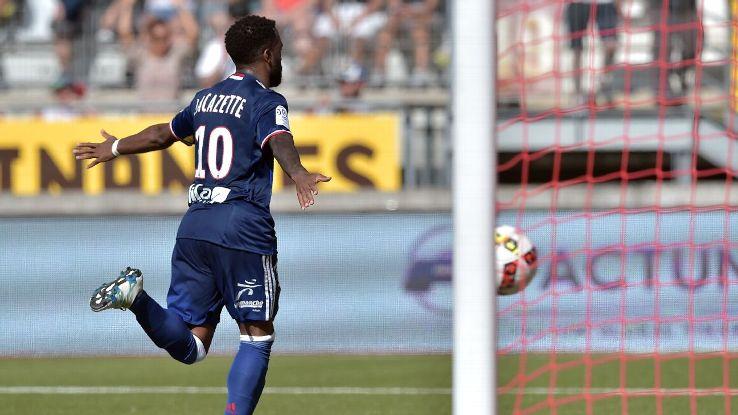 Lyon's French forward Alexandre Lacazette celebrates after scoring a goal in a 3-0 win versus Nancy.