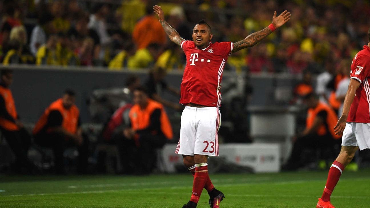 Arturo Vidal celebrates after opening the scoring for Bayern Munich in the German Super Cup.